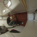 Sanding the aft bulkhead in the aft cabin.